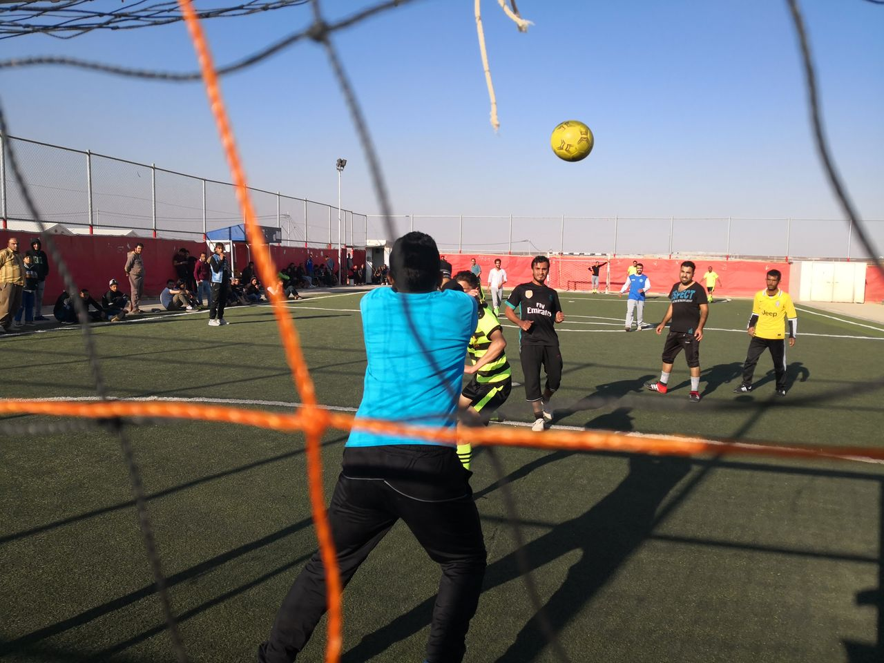 Footballtournament in the Camp. The team of World Vision is playing against a team of CARE.